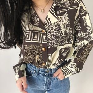Vintage blouse with a bold leopard
